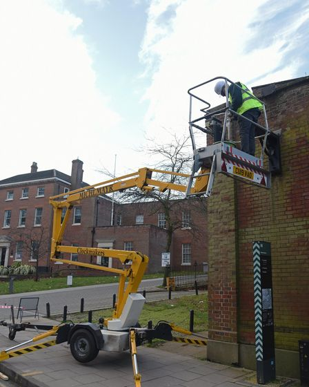 Michlmayr Clock & Watchmakers getting the site ready to put the restored Norwich Union clock back up