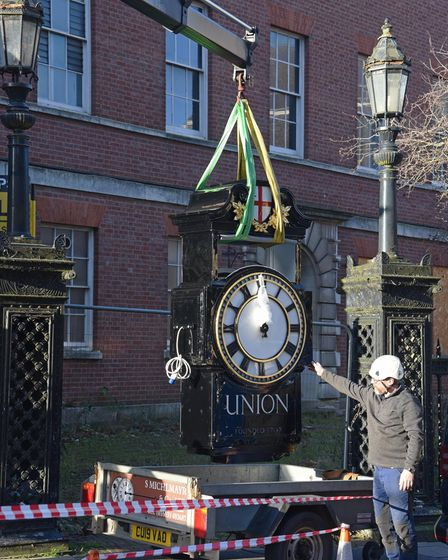 The restored Norwich Union clock being lifted ready to be put back on Surrey Street in Norwich.
