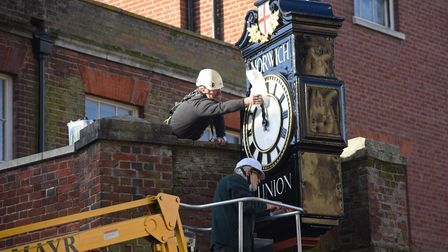 Michlmayr Clock & Watchmakers putting the final touches on the restored Norwich Union clock which ha