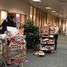 South Devon High School pupils, wearing face masks, with piles of wrapped Christmas gifts