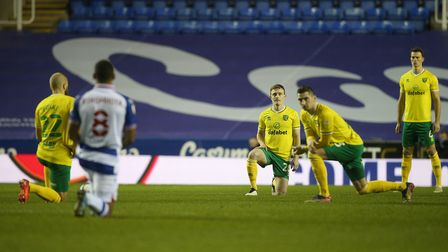 The players take a knee before the Sky Bet Championship match at the Madejski Stadium, Reading