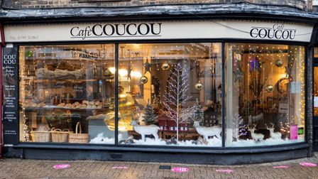 Christmas window of a cafe with deer figures and fake snow