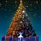 A ballet dancer in front of a large Christmas tree surrounded by gifts