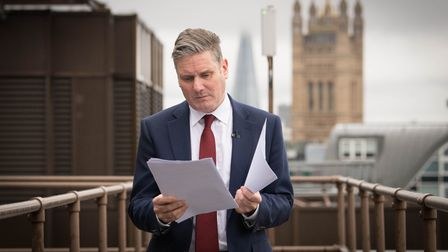 Labour leader Sir Keir Starmer reads through his notes shortly before delivering a virtual speech
