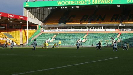 The players take a knee before the Sky Bet Championship match at Carrow Road, Norwich