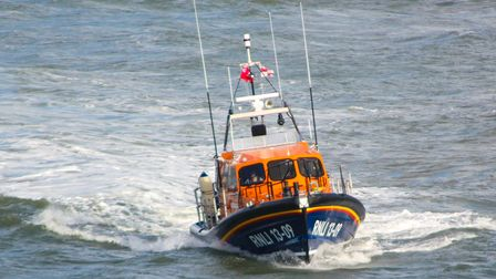 An image showing the Ilfracombe all-weather lifeboat speeding across the sea