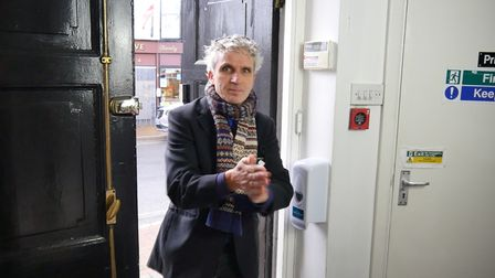 PloughArts director Richard Wolfenden-Brown sanitises on entering the building.