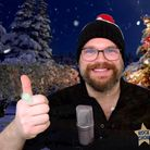 Tom George of Rock Choir gives a thumbs up