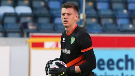 U23 goalkeeper Jon McCracken warming up with the Norwich first team ahead of a League Cup tie at Wyc
