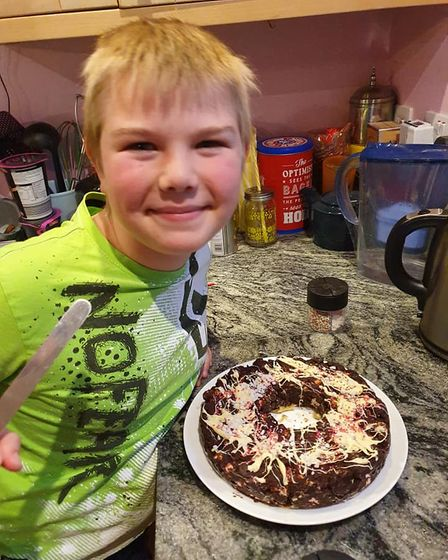 A young person making a chocolate treat