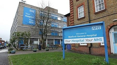 Front of Watford General Hospital with welcome sign at entrance