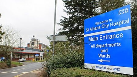 Front of St Albans City Hospital with welcome sign at entrance