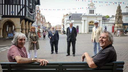 Friends Tony Calver and John Byatt sit for a socially distance chat in the market place with Saffron