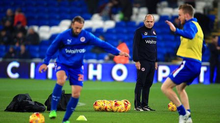 New Stevenage assistant manager Dean Wilkins oversees the warm up at Reading