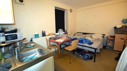 A flat inside England's Lane Residence, where a mother sleeps with her two children in the same bed