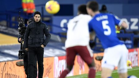 Arsenal manager Mikel Arteta (left) watches from the touchline during the Premier League match at Go