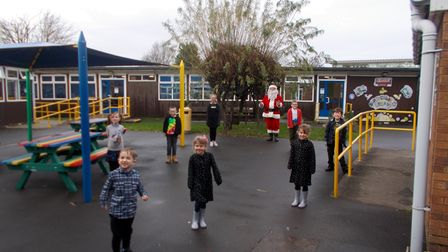 Santa delivers presents for children at Windwhistle Primary School on behalf of the Axentis Michael Charitable Trust.