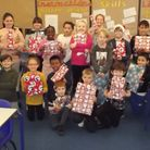 Windwhistle Primary students with their Christmas gifts.