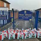 15 Christmas bags at gates of How Wood school