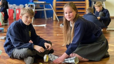 Two pupils wrapping presents