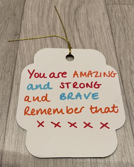 Label that reads 'You are amazing and strong and brave, remember that'