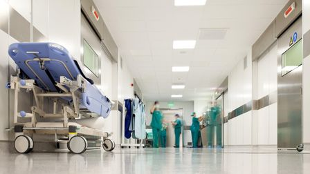 Blurred figures of people with medical uniforms in hospital corridor. Picture: Getty Images/iStockph