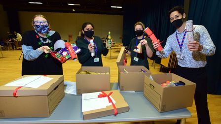 Haverstock School staff Lisa Smith, Jemi Parel, Laura Concallon and Eden Confino helped to pack hampers.