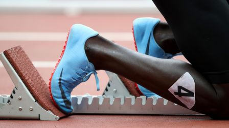 Athletics stock - an athlete gets set in the starting blocks at the beginning of a race