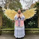 Reverend Ben Bell poses with angel wings