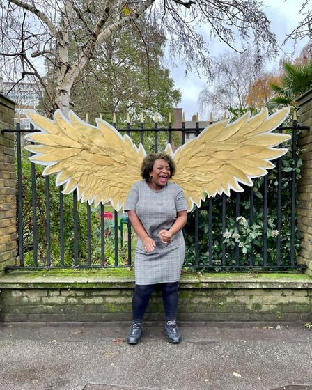 A St Anne's churchwarden poses with angel wings.