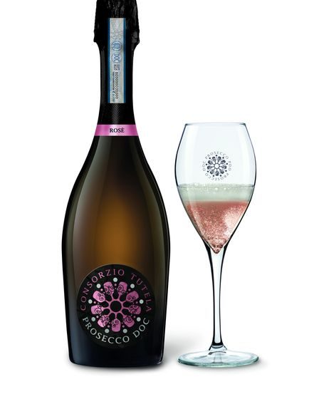 A bottle of prosecco rose and glass