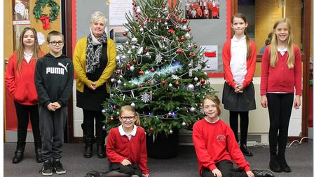 MrsHerbert, a member of Gunton Primary Academylearning support staff, is pictured withsome of the school'sUpper Key...
