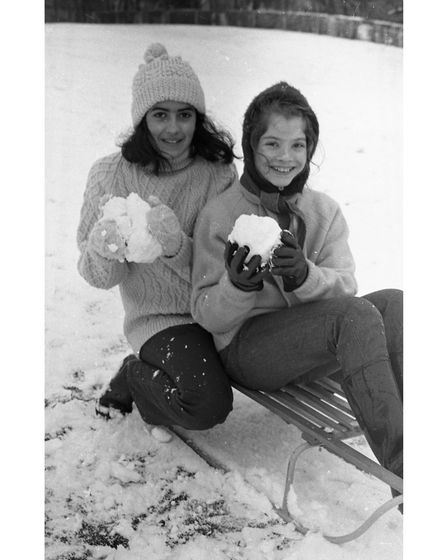 Using sledges during snowball fights at Christchurch Park Ipswich in 1970
