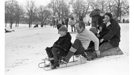 Fitting as many as possible onto a sledge as kids take on the hills at Christchurch Park after havin