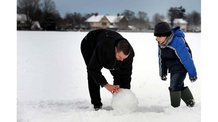 Making a snowman on The Green at Great Bentley, Colchester, in 2010