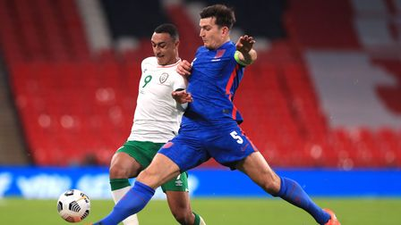 Republic of Ireland's Adam Idah (left) and England's Harry Maguire battle for the ball during the in