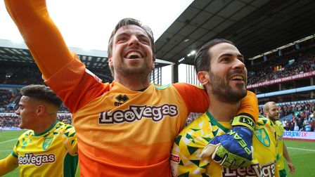 Tim Krul, centre, started the move from which Mario Vrancic, right, scored Norwich City's winner at
