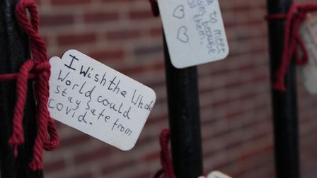 'I wish the whole world could stay safe from Covid,' reads a message on the gates at Mulberry House School.