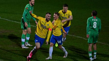 Goal celebrations for Kyle Cameron of Torquay United after he heads the ball into the net during th