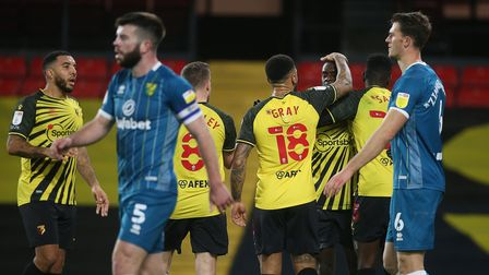 The Norwich players look dejected as Ismaila Sarr of Watford celebrates scoring his sideÕs 1st goal