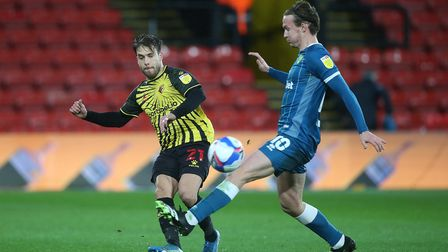 Kiko Femenia of Watford and Kieran Dowell of Norwich in action during the Sky Bet Championship match