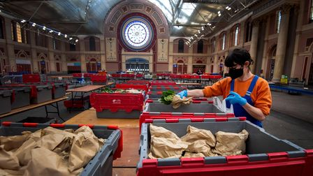 Volunteers from the Edible London food project help to prepare food parcels at Alexandra Palace in L