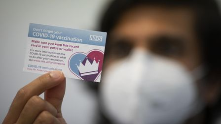 A Covid-19 vaccination card after a patient had a dose of the Pfizer/BioNtech covid-19 vaccine at th