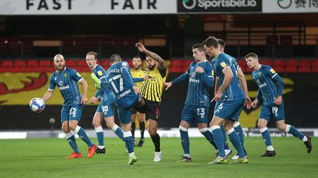 Emiliano Buendia of Norwich clears the ball during the Sky Bet Championship match at Vicarage Road,