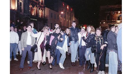 New Year celebrations with crowds dancing on Ipswich Cornhill in 1989