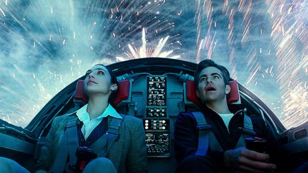 Gal Gadot as Wonder Woman and Chris Pine as Steve Trevor flying a plane