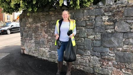 Friends for Pets collecting discarded dog waste bags scattered across Axbridge in June 2019.