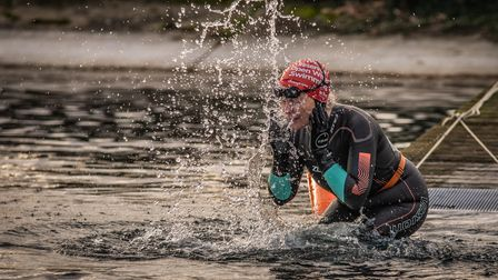 A woman splashes her face with the reservoir water.