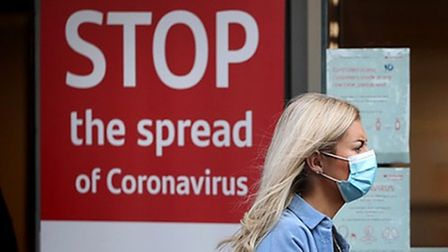 stop the spread of coronavirus lady in mask