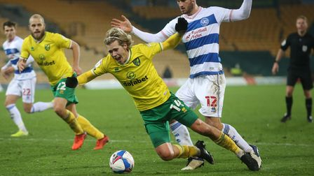 Todd Cantwell of Norwich is fouled by Dominic Ball of Queens Park Rangers and a penalty is awarded b